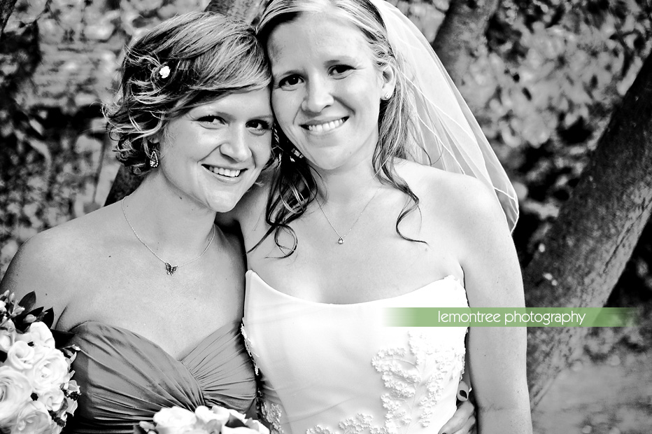 bride with sister at hampshire wedding reception