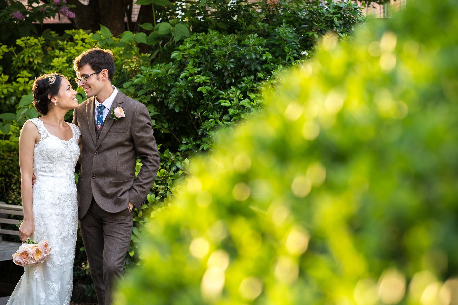 bride and groom in walled garden scaplen's court
