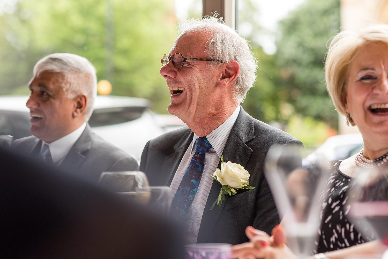 guests smiling at wedding