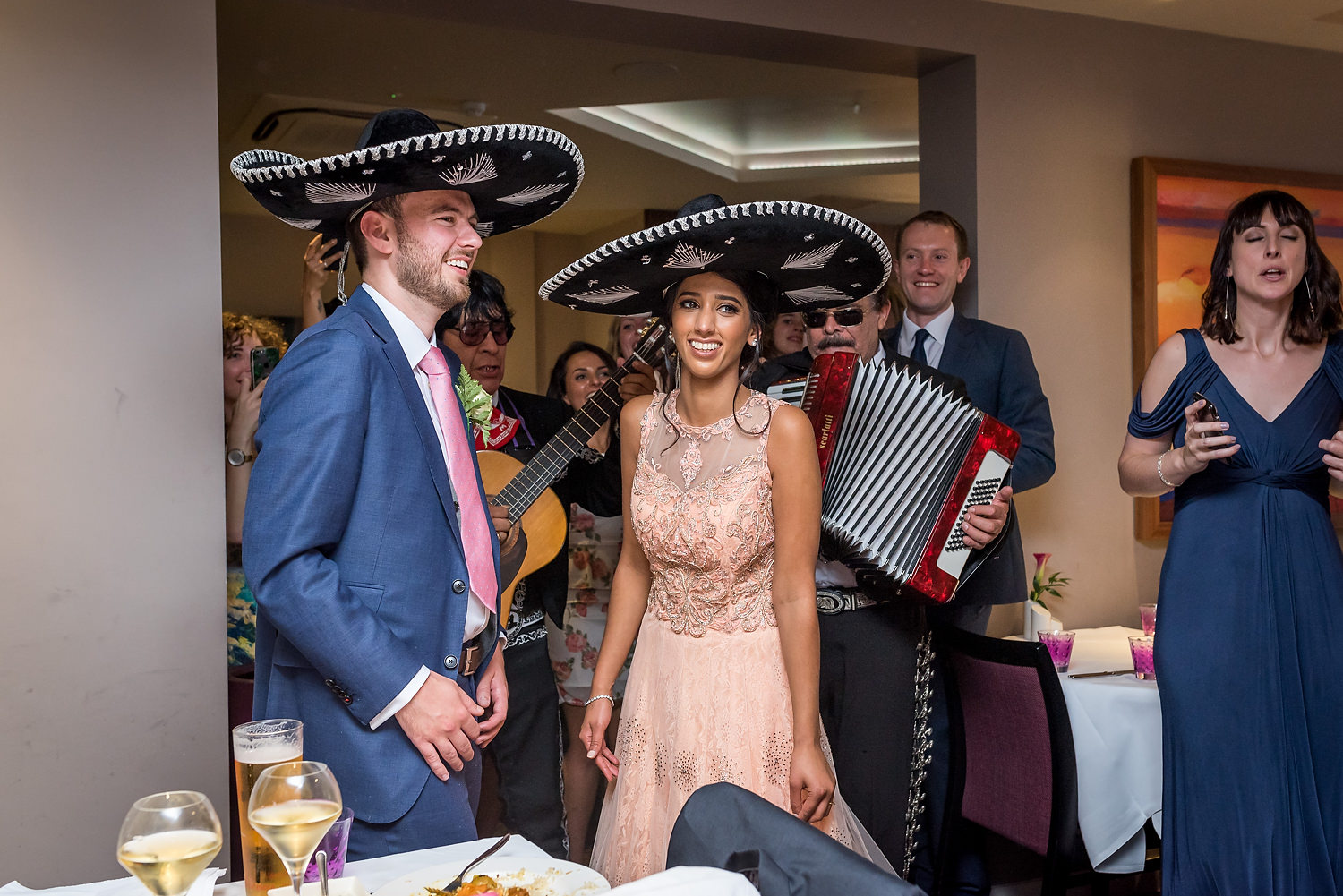 mariachi band with bride and groom