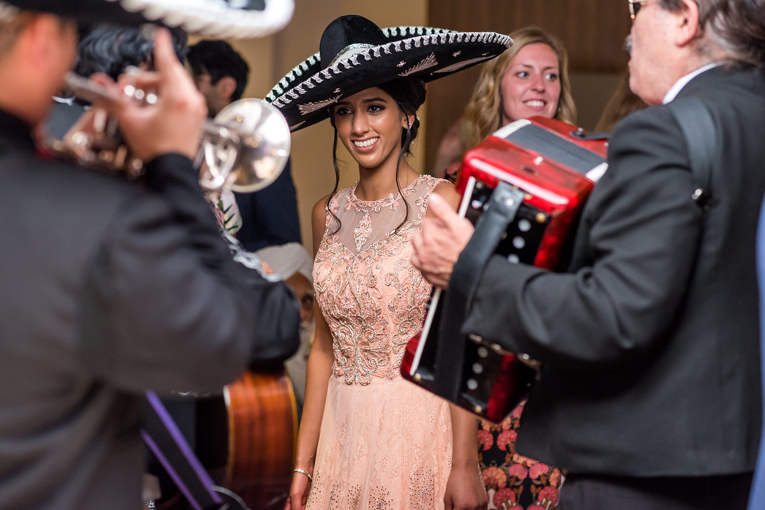 bride smiling with mariachi band