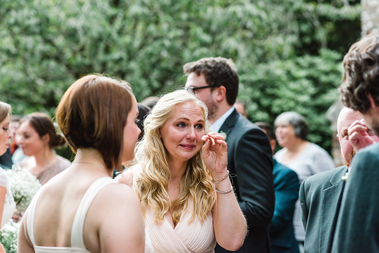 bridesmaid crying at wedding