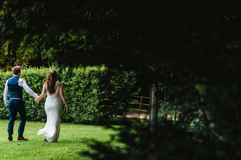 bride and groom walking at penton park