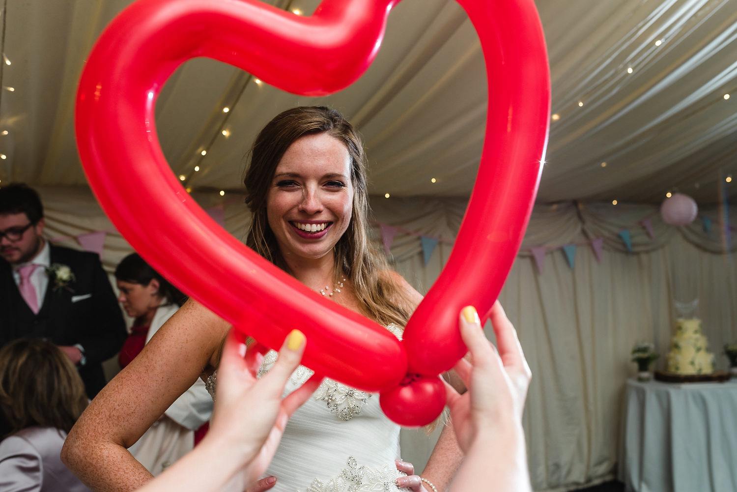 bride with heart balloons