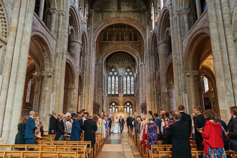walking down aisle a romsey abbey wedding