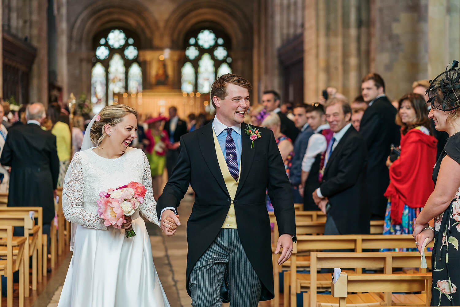 couple walking down aisle at romsey abbey