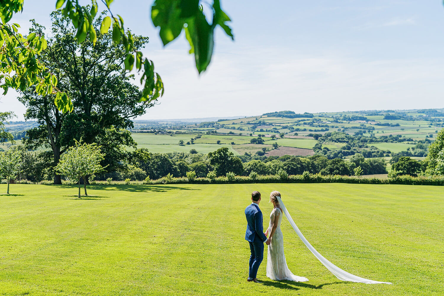 bride and groom looking at dorset countryside
