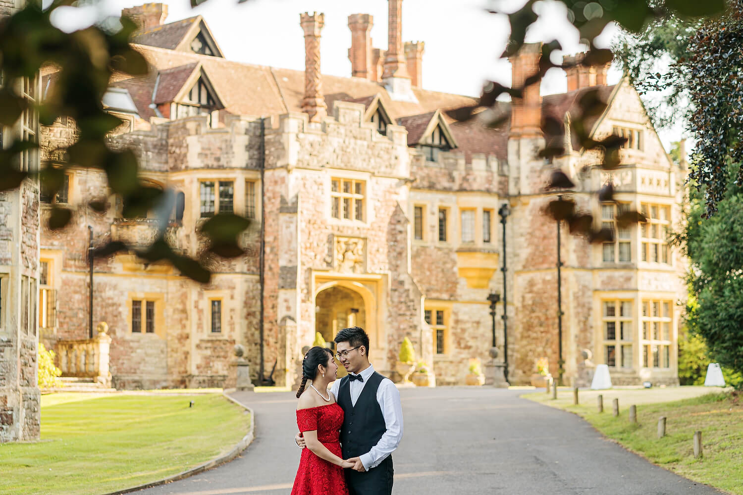 bride and groom outside rhinefield house