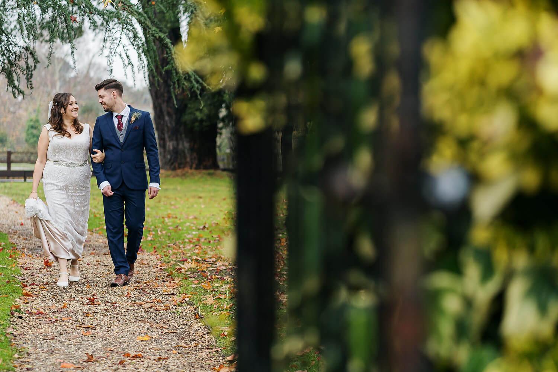 couple walking at careys manor wedding