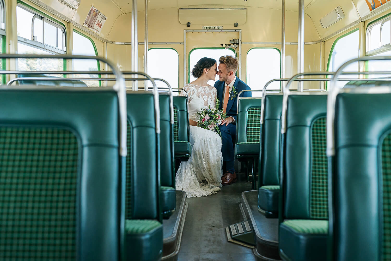 bride and groom on bus in southsea wedding