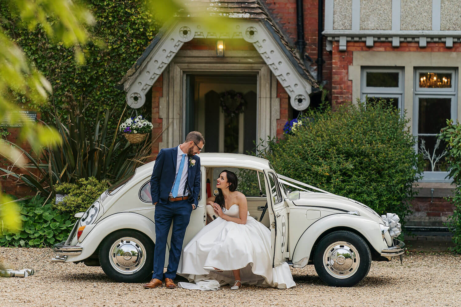 bride with vw beetle at the old vicarage