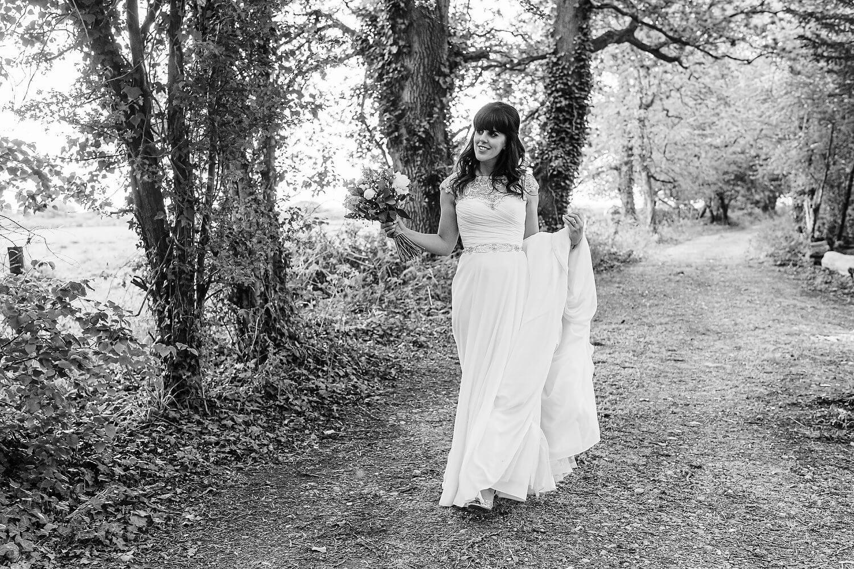 bride walking at tournerbury woods wedding