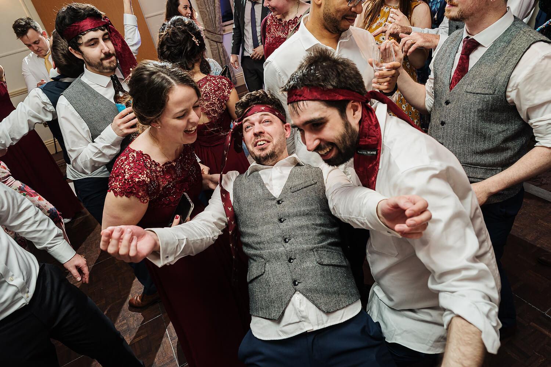 groom dancing at careys manor wedding