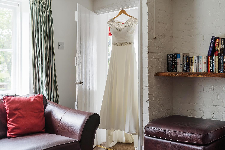 brides wedding dress in doorway