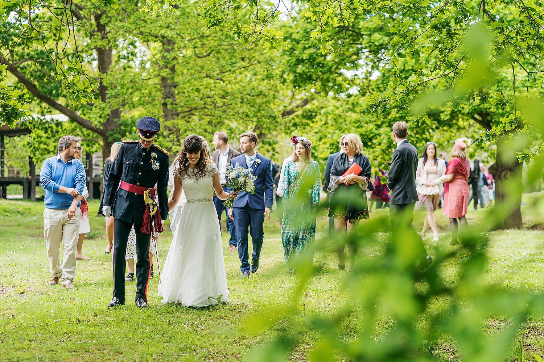 bride and groom walking at hayling island wedding