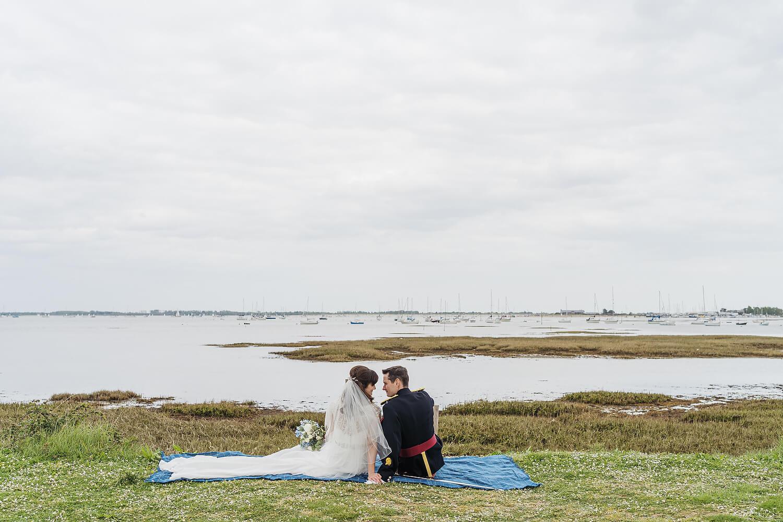 bride and groom overlooking water at tournerbury woods estate
