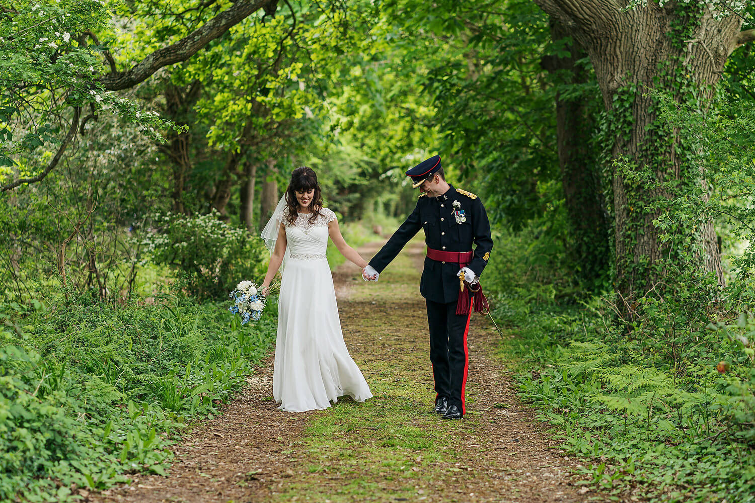 bride and groom walking tournerbury woods estate wedding