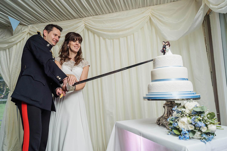 cutting wedding cake at tournerbury woods