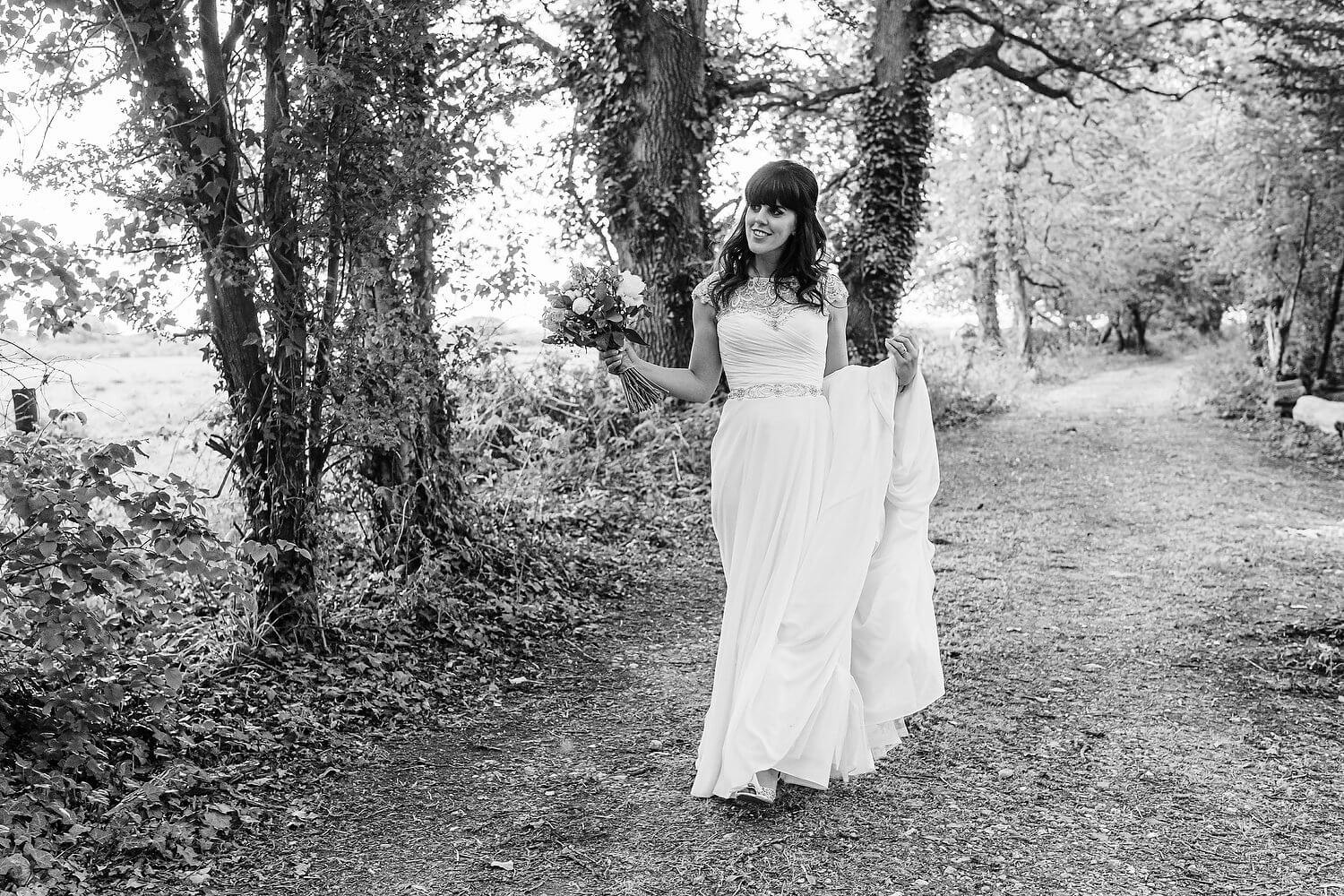bride walking at tournerbury woods estate