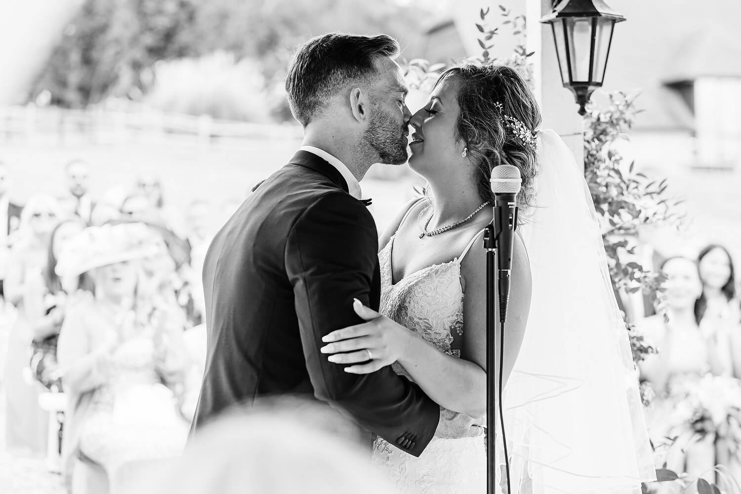 bride and groom kiss at lythe hill hotel surrey