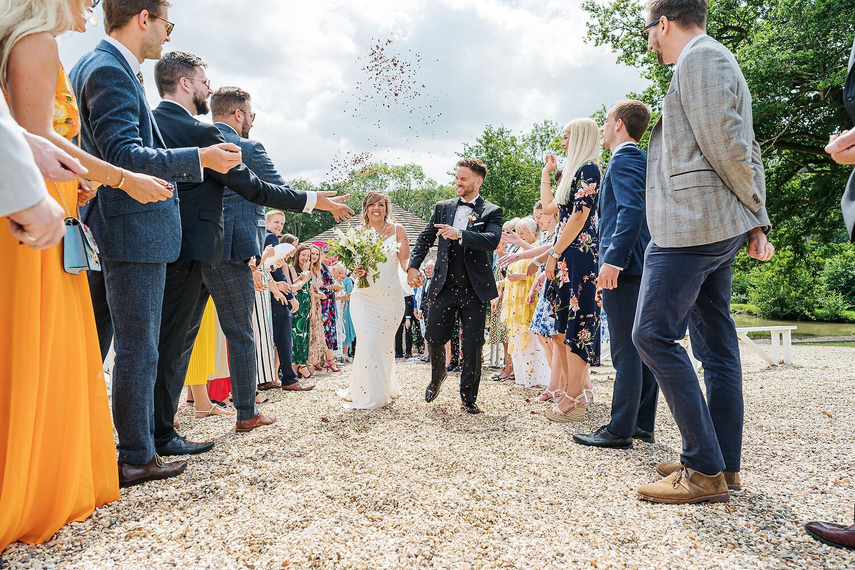 outdoor confetti at surrey wedding