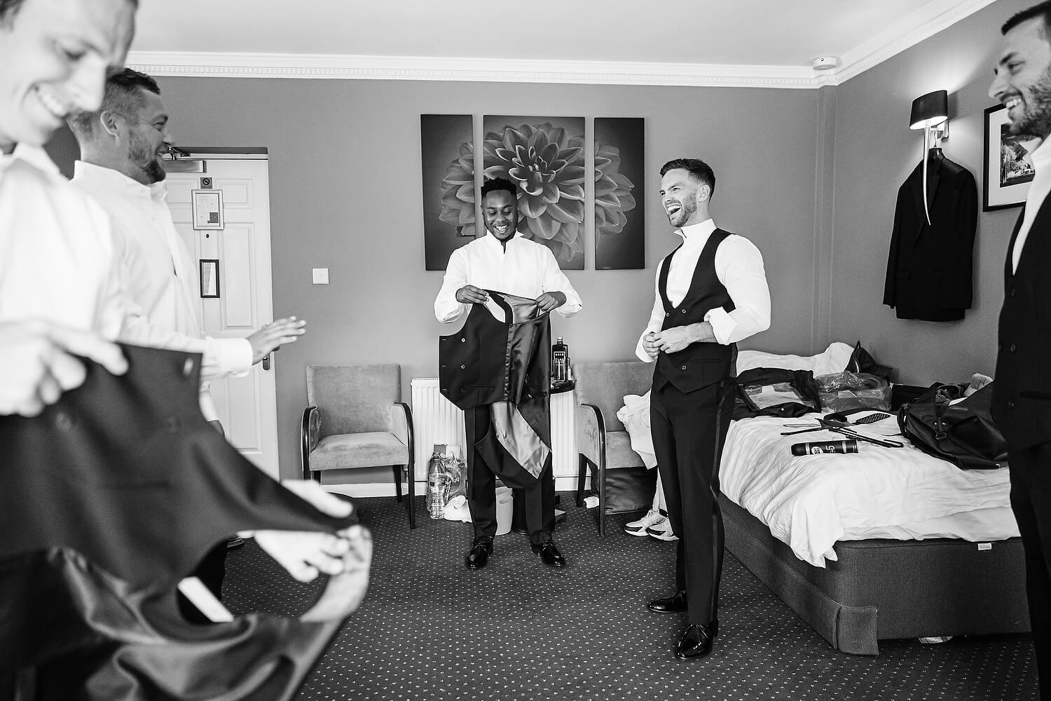 groom getting ready with bestmen at lythe hill hotel