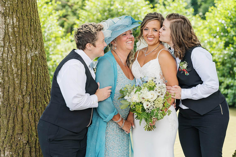 bride with family at surrey wedding