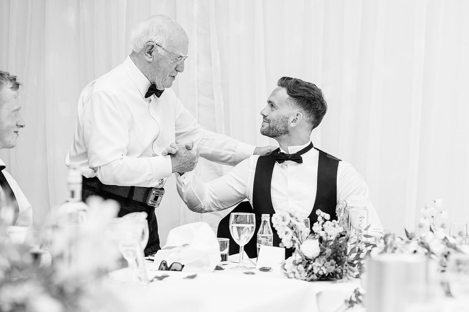 groom with grandfather at wedding