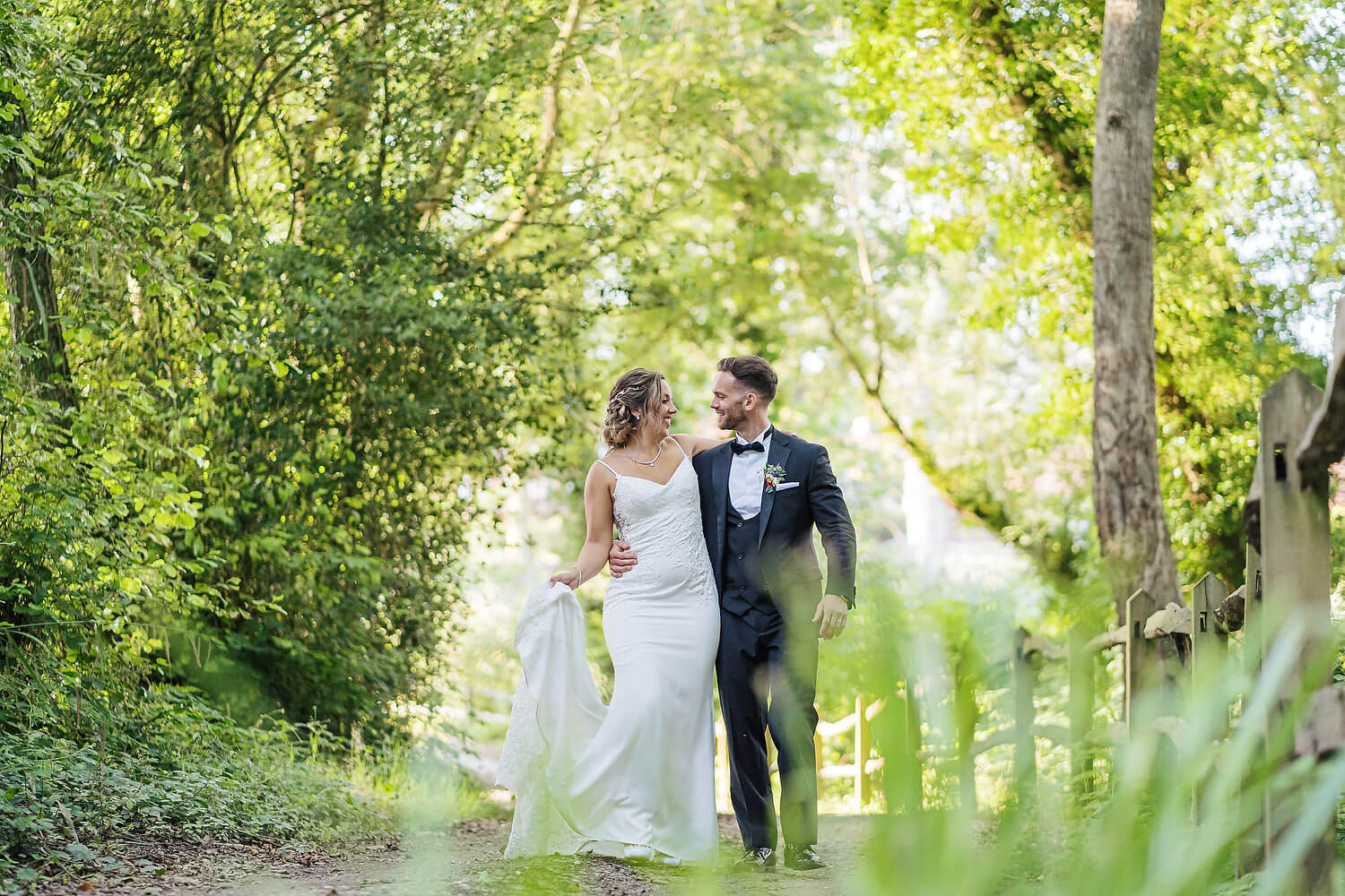 bride and groom walking at lythe hill hotel surrey