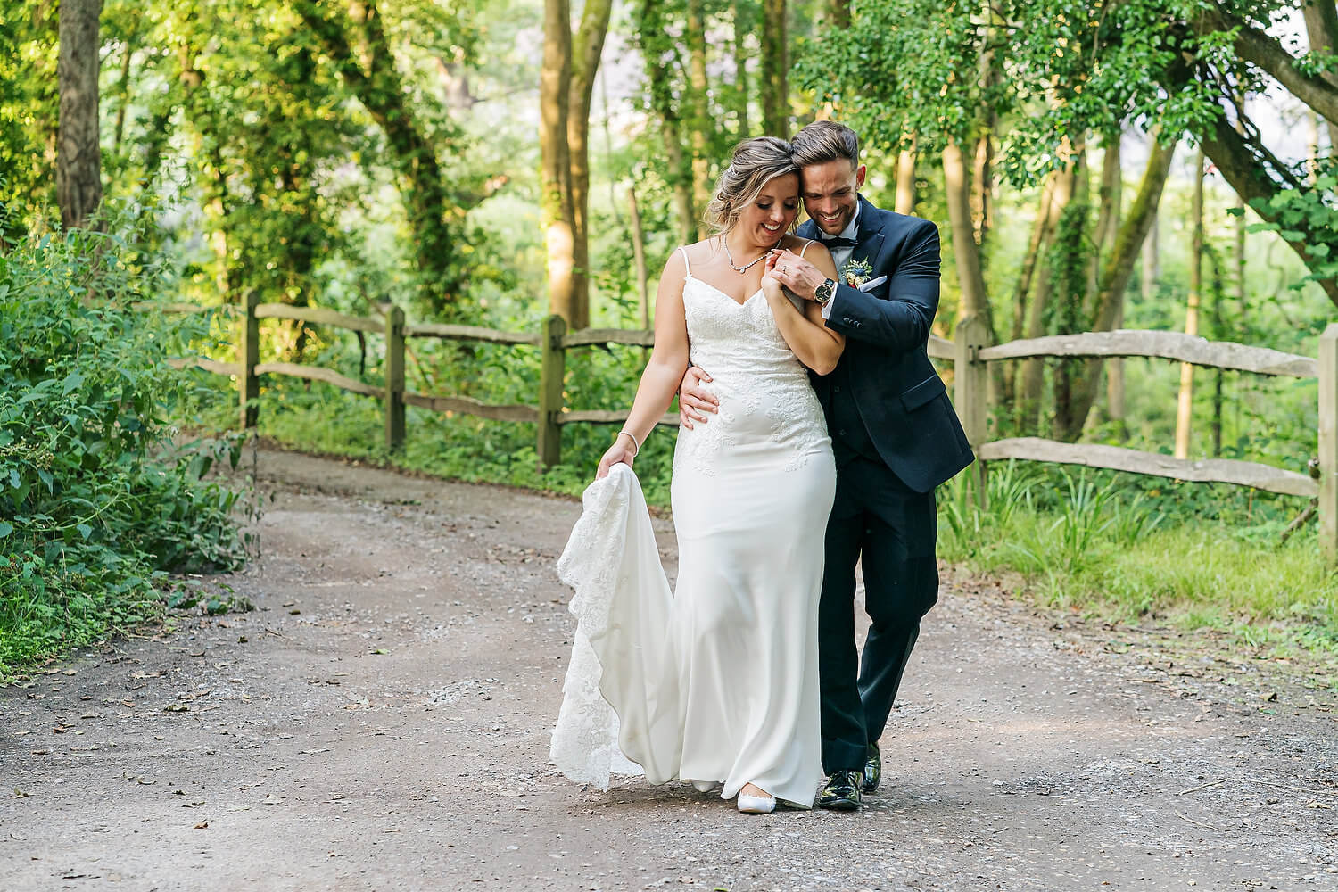 bride laughing with groom at surrey wedding