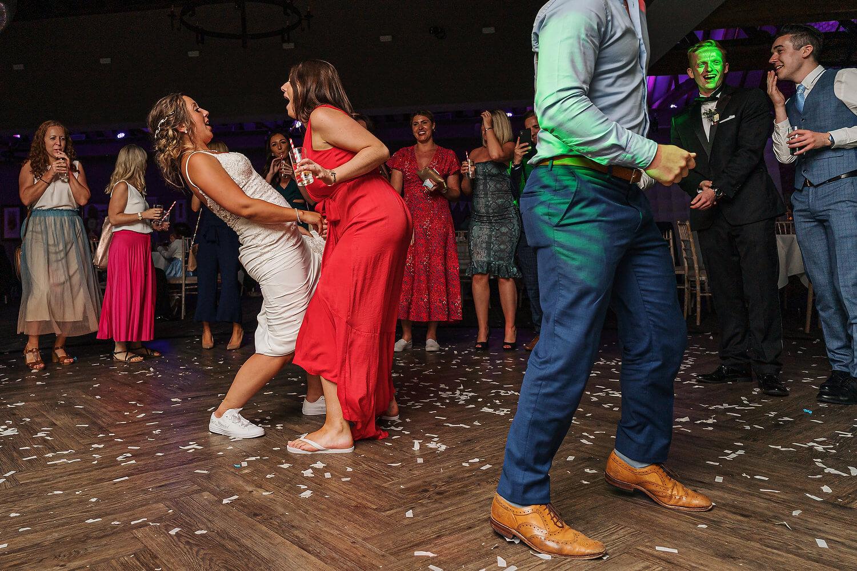 bride dancing with friend at surrey wedding