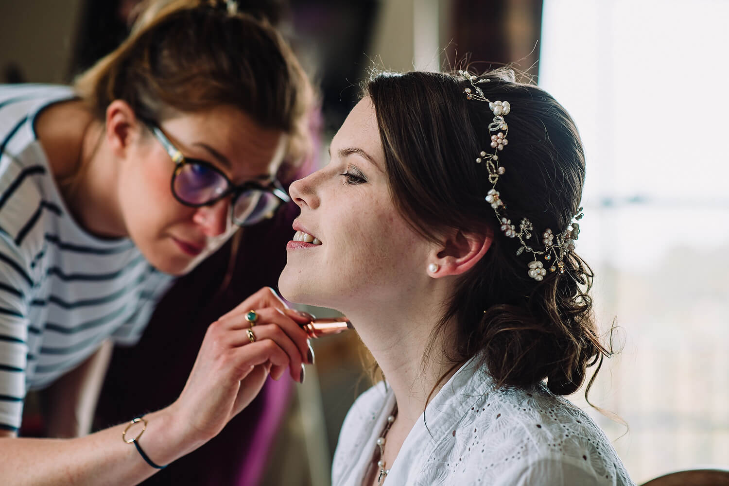 bride getting make up at froyle park