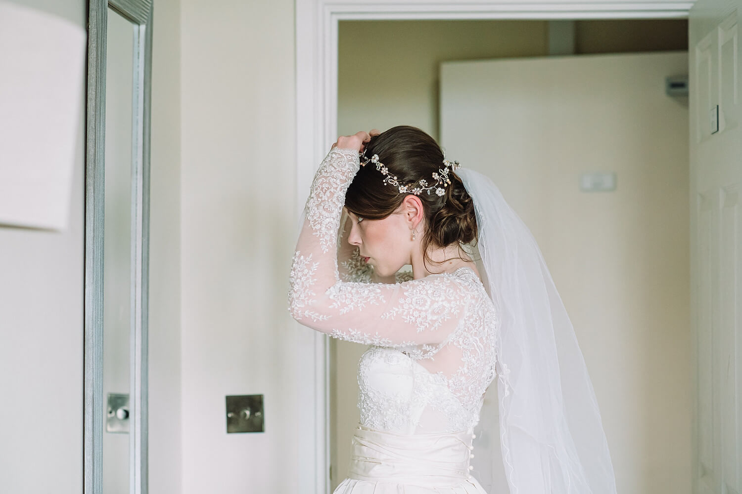 bride getting ready at froyle park in hampshire