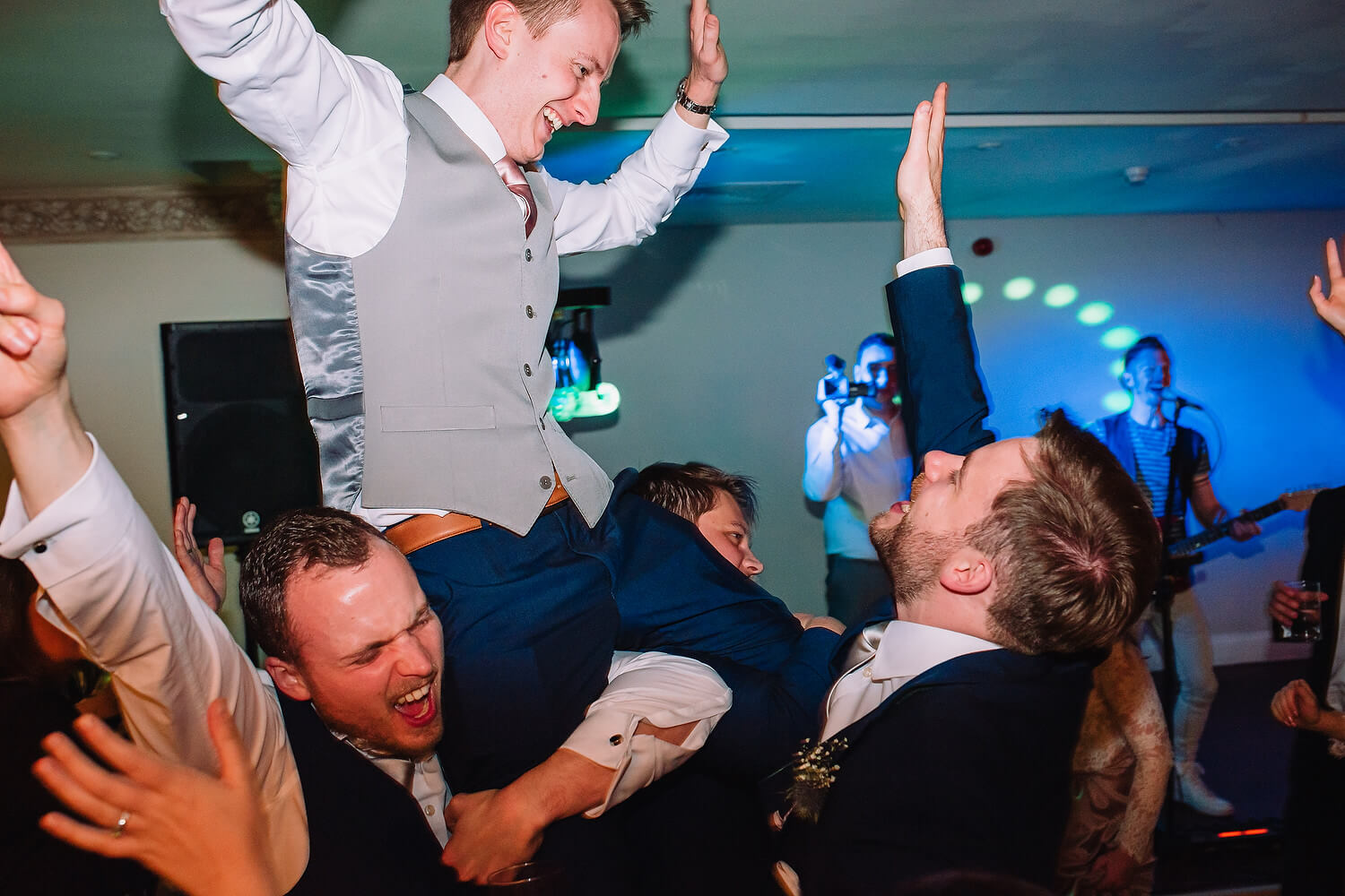groom on shoulders at wedding