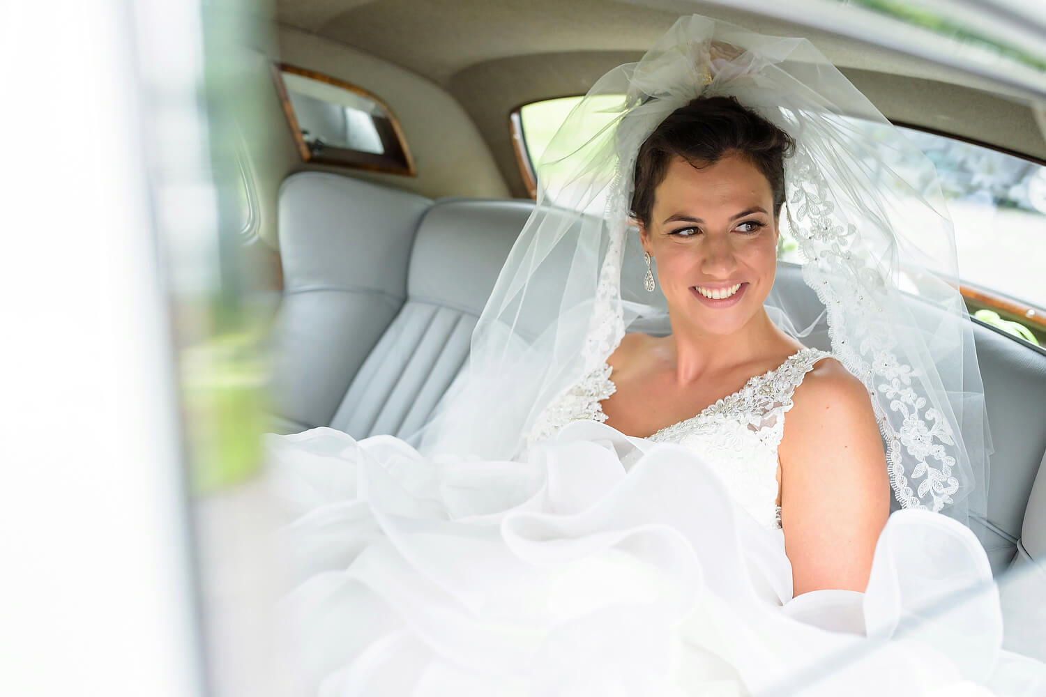 bride in car at lulworth castle wedding