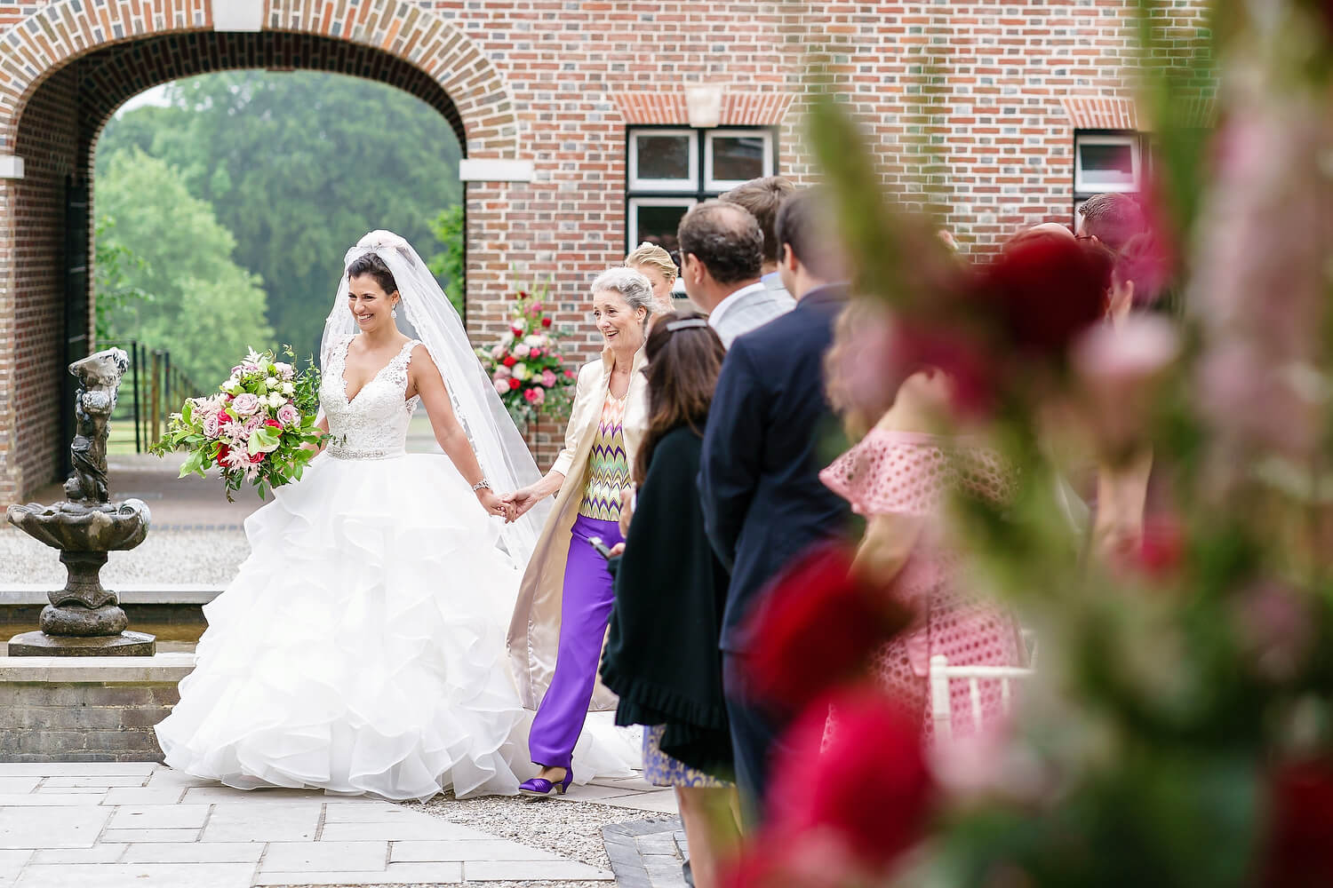 bride walking down aisle at lulworth estate