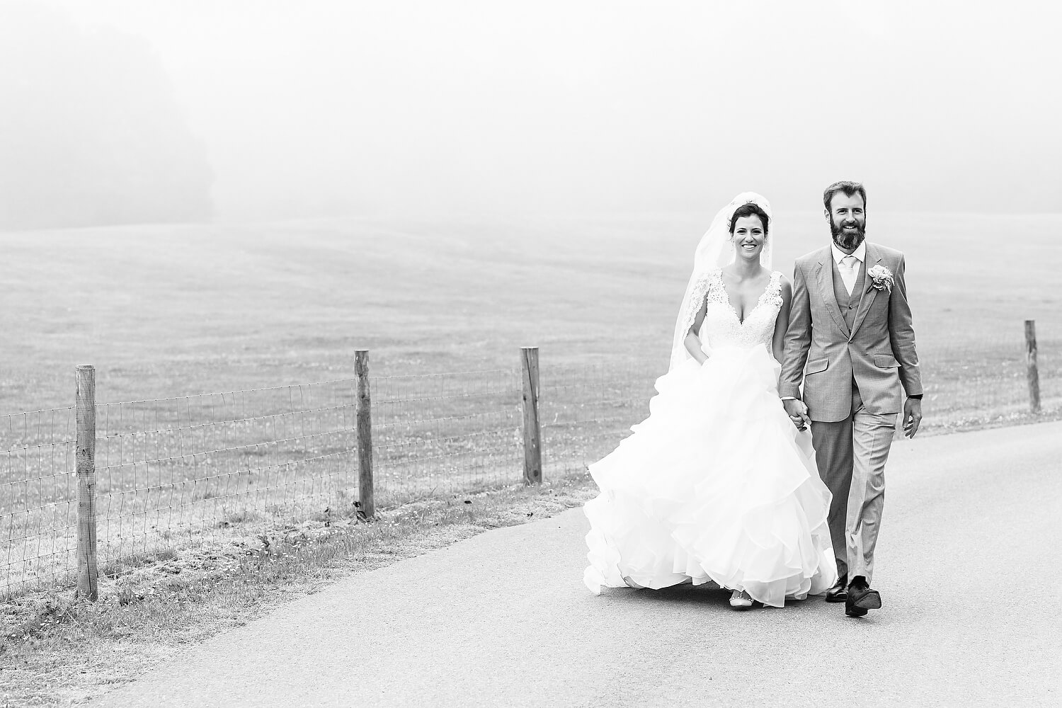 bride and groom walking in dorset