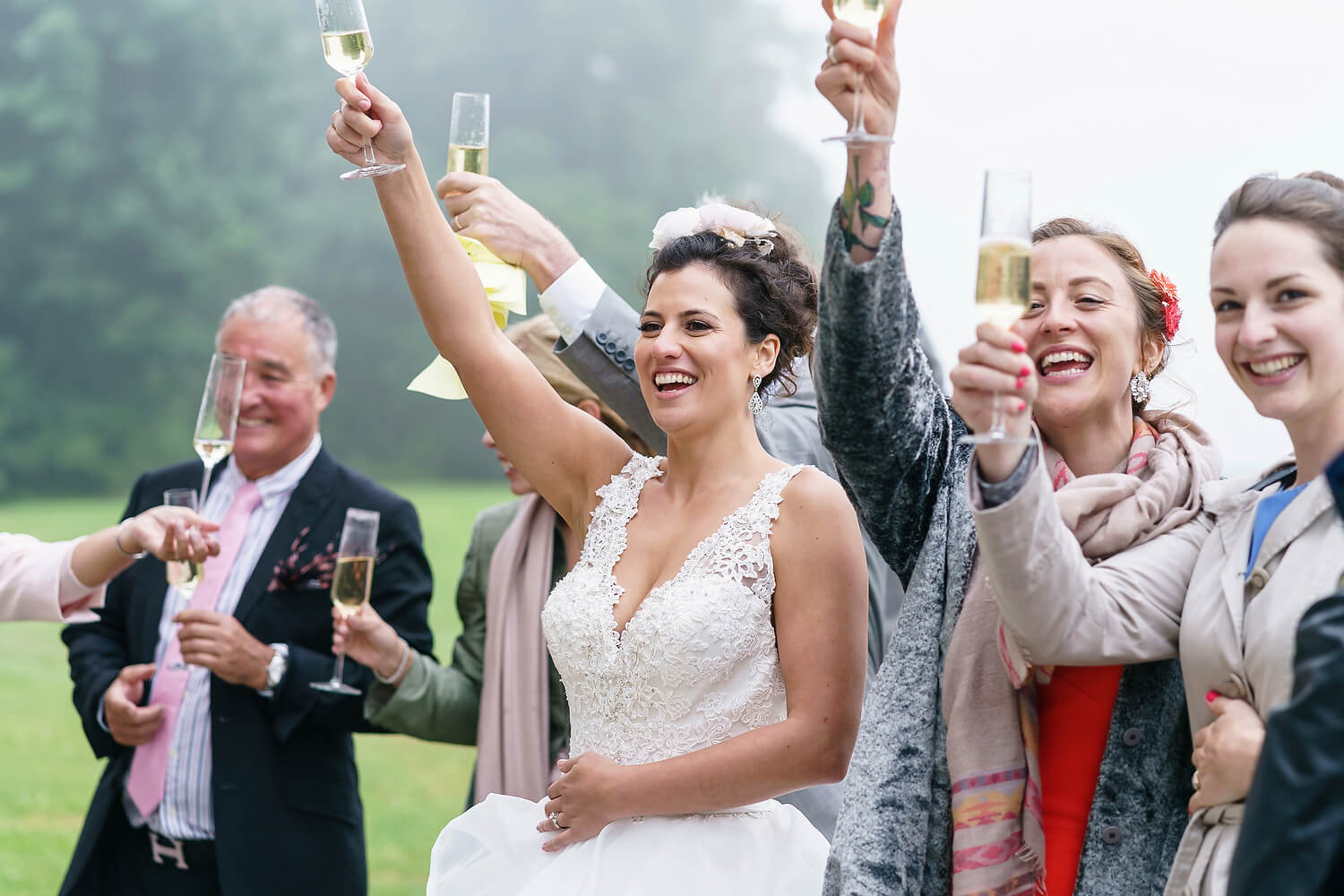 bride laughing at lulworth castle wedding