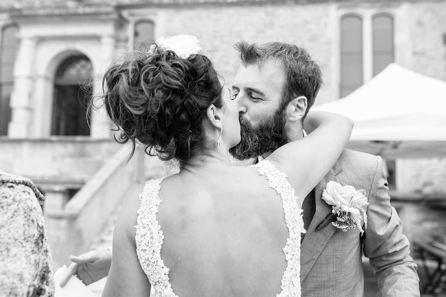 bride and groom kissing at lulworth castle