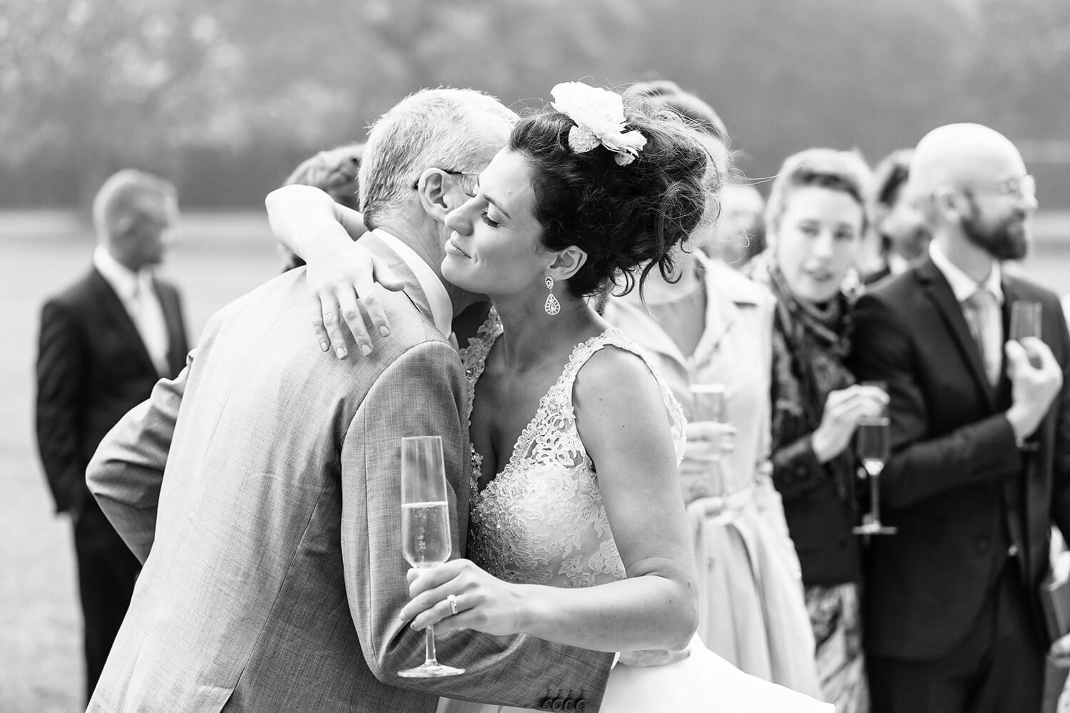 bride embracing father at wedding