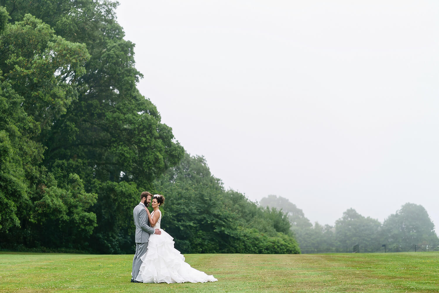 bride and groom at lulworth castle