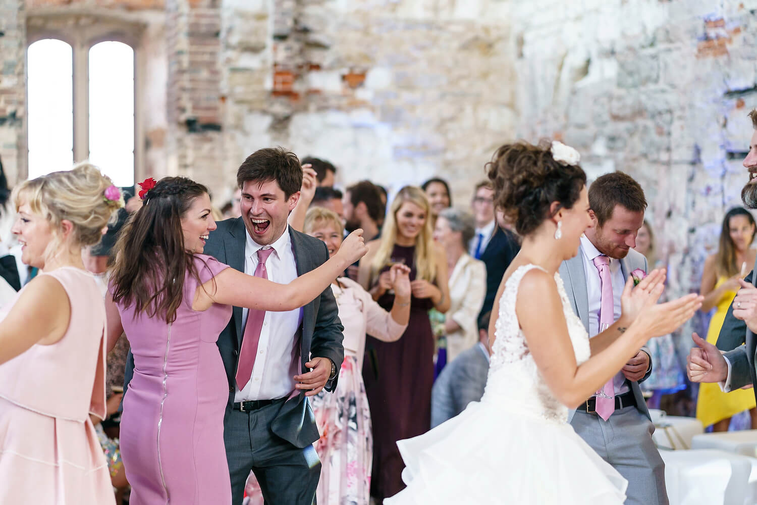 wedding guests dancing at lulworth castle