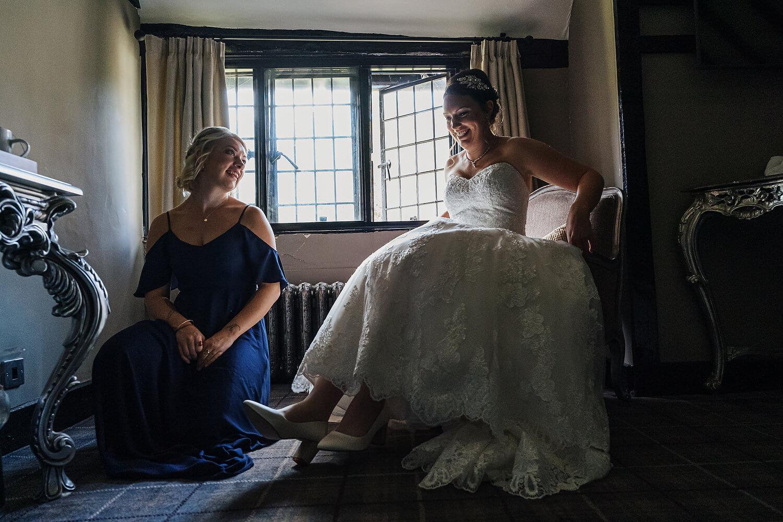 bride and bridesmaid at surrey wedding