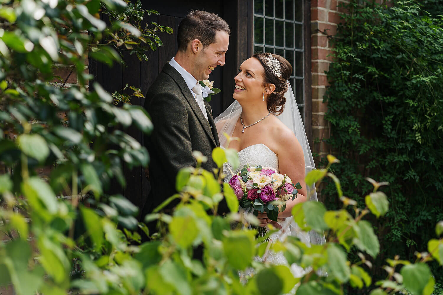 bride and groom portraits at surrey wedding