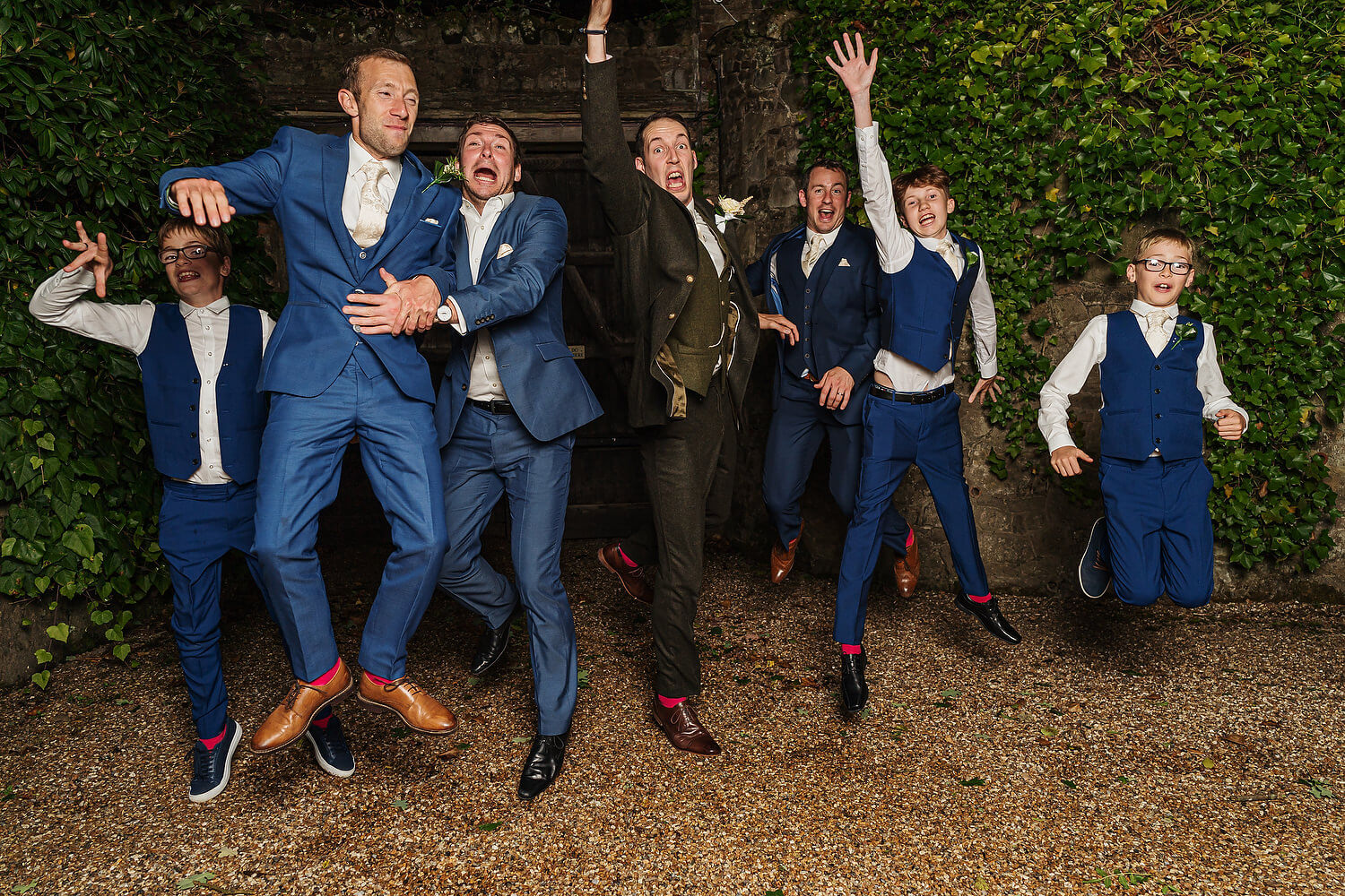 groom jumping at ramster hall wedding