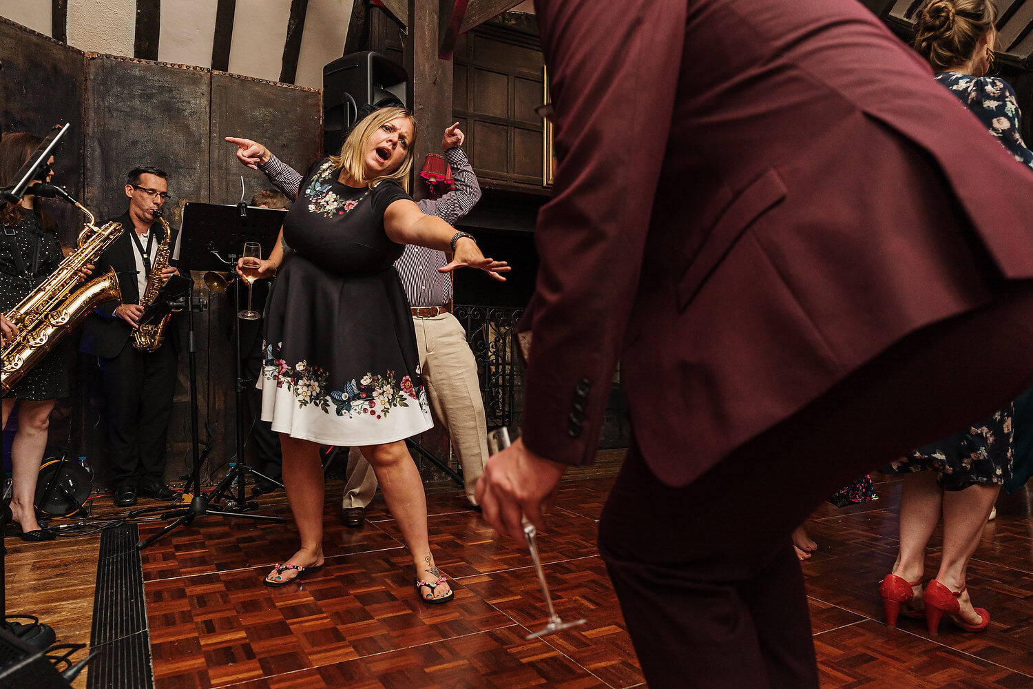 wedding guests on dance floor in surrey