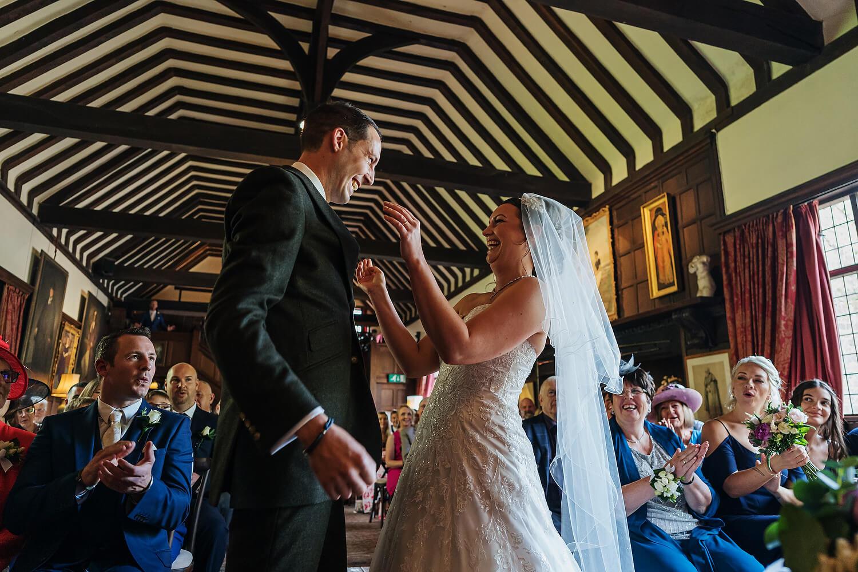 bride and groom kissing at surrey wedding