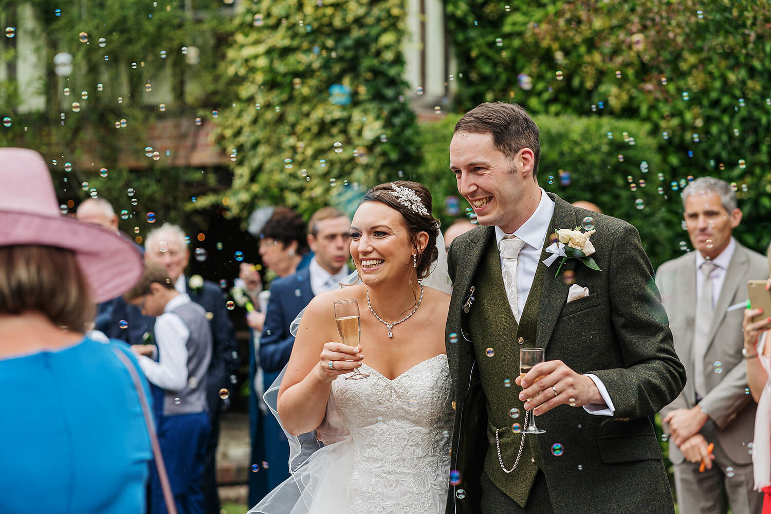 bride and groom laughing at surrey wedding