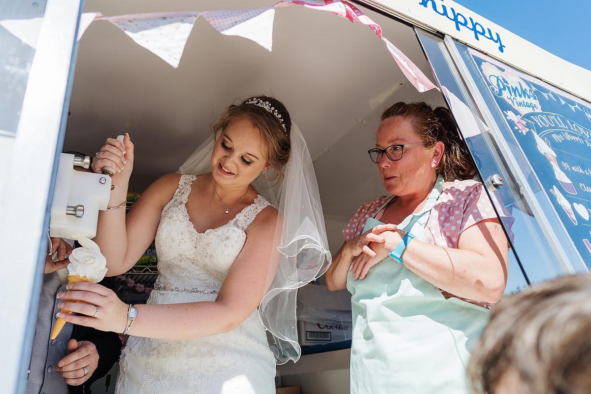 bride serving ice cream at chichester wedding