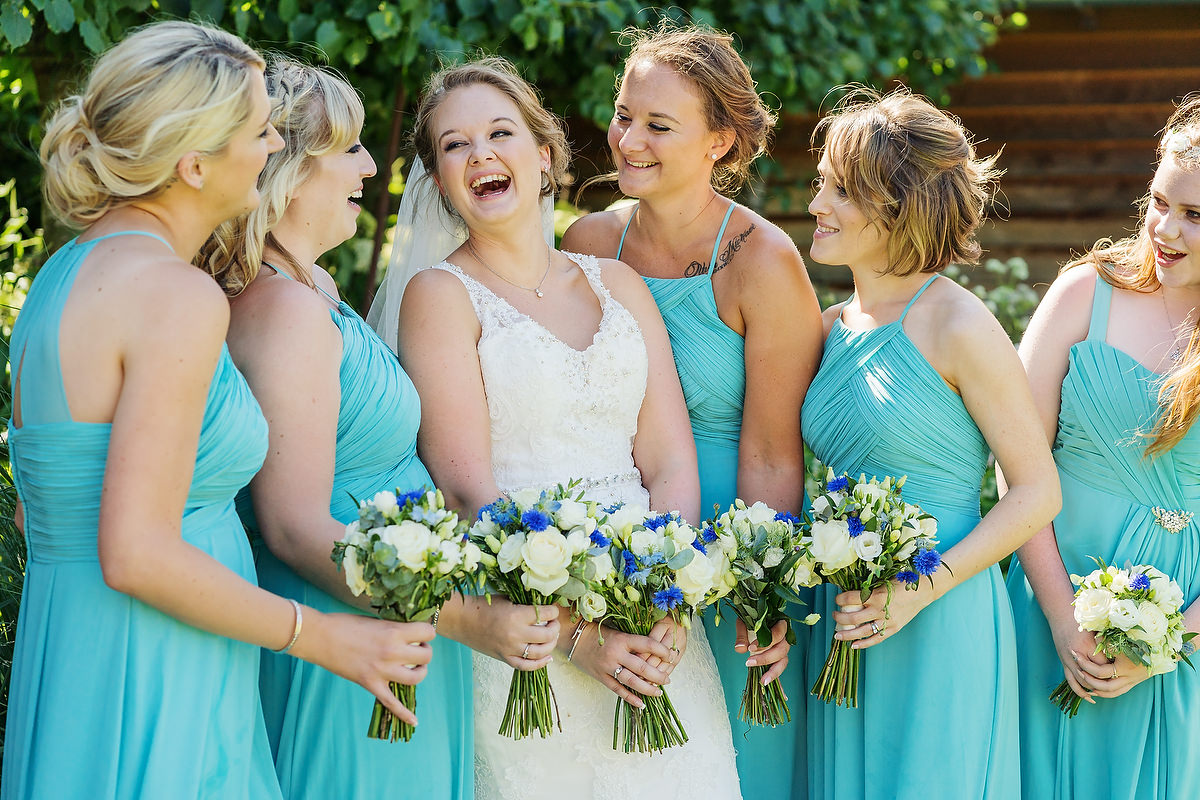 bride laughing with bridesmaids at west sussex wedding